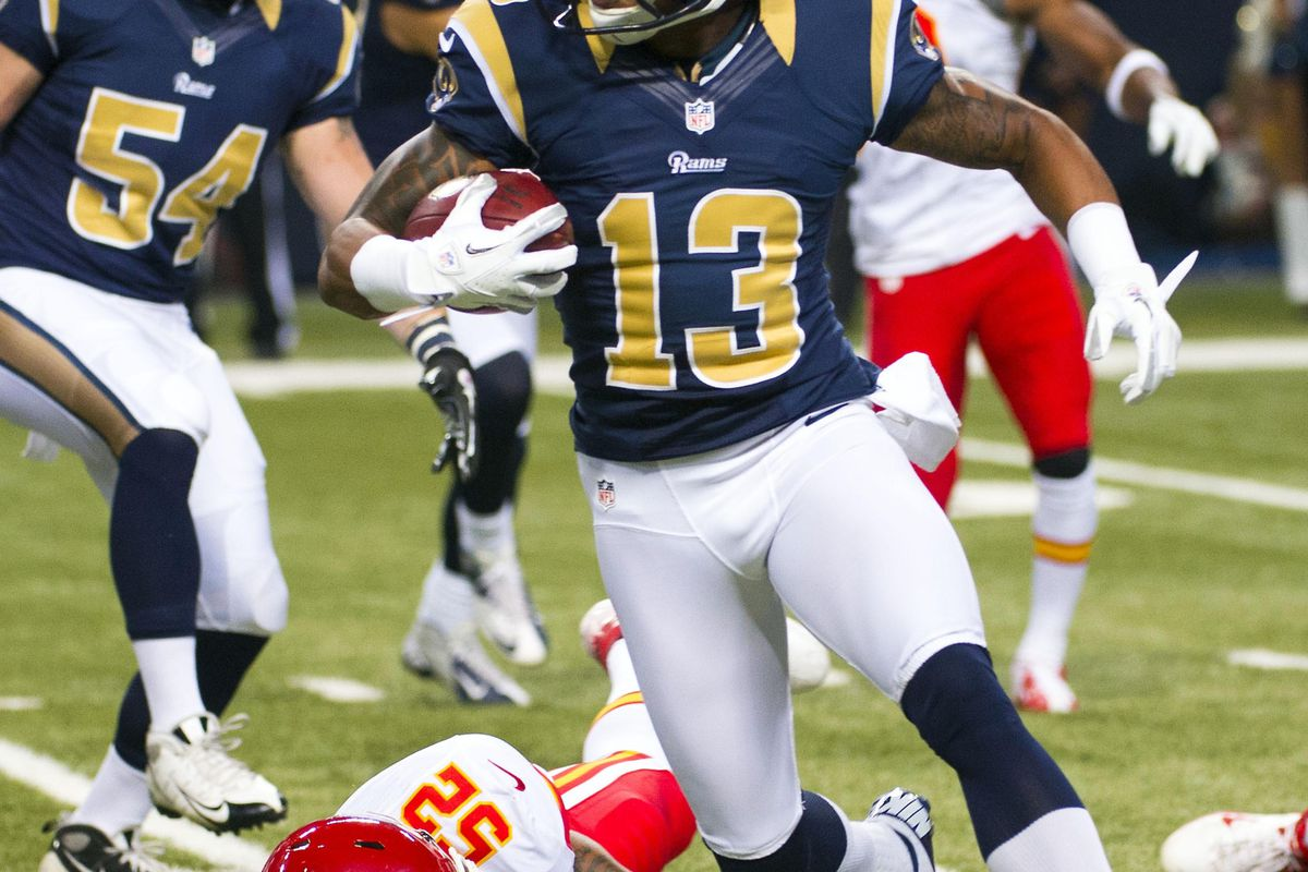 Aug 18, 2012; St. Louis, MO, USA; St. Louis Rams wide receiver Chris Givens (13) breaks away from Kansas City Chiefs linebacker Brandon Siler (52) during the first half at the Edward Jones Dome. Mandatory Credit: Photo by Scott Rovak-US PRESSWIRE