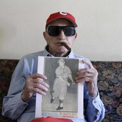 Cuban former pitcher Conrado Marrero, who once played with the Washington Senators, shows a photography of him on an old newspaper as he speaks during an interview in Havana, Cuba, Wednesday, April 25, 2012. Marrero, who last year became the oldest living former big leaguer, turned 101 on Wednesday.