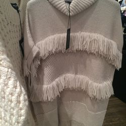 Fringed sweater, $325 (from $1,490)