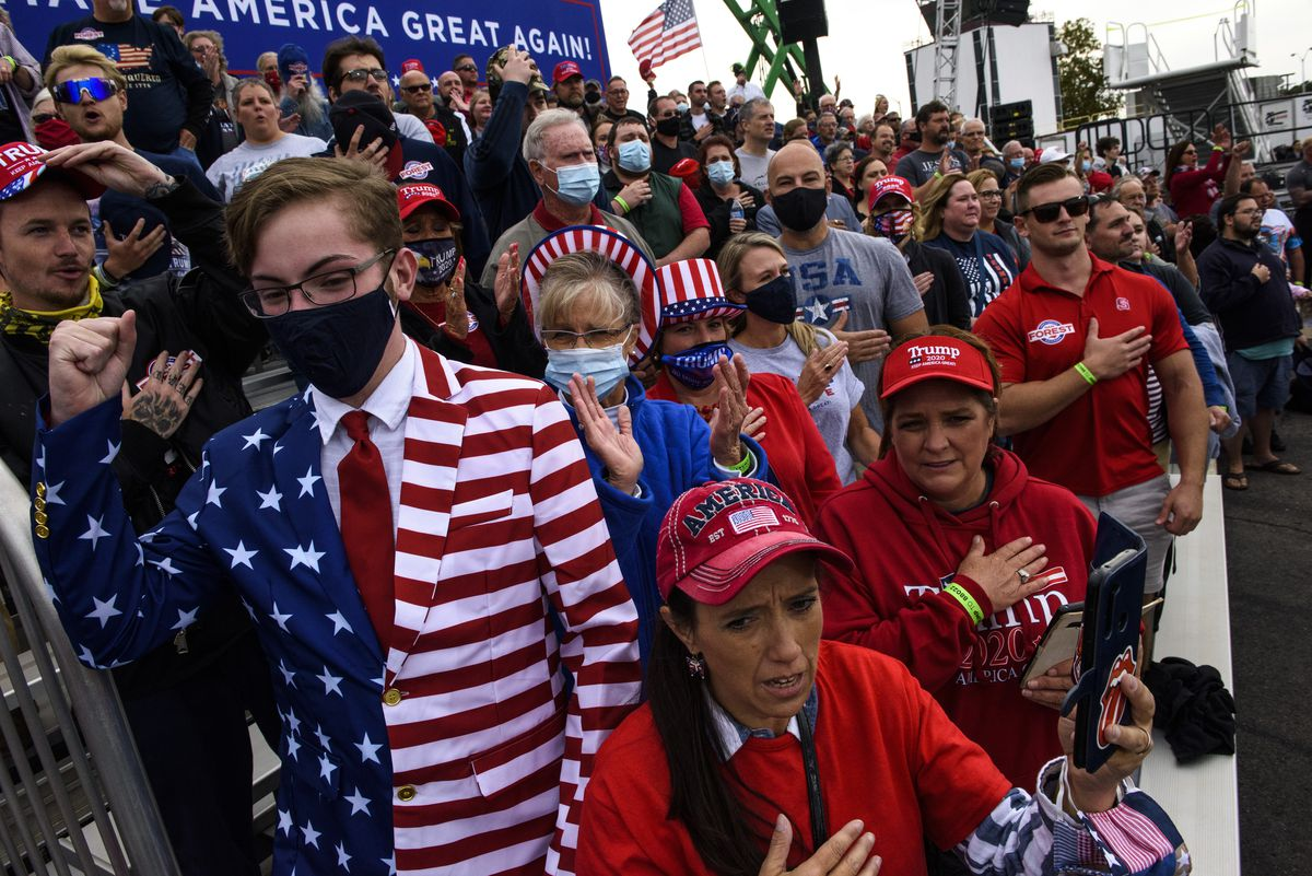 Crowd members cheer toward cameras before the arrival of President Donald Trump to a Make America Great Again rally on September 19, 2020 in Fayetteville, North Carolina.
