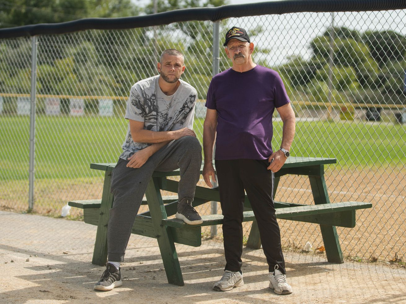 Bernard Ralich, right, and his son Daniel, live near the Hegewisch Babe Ruth youth baseball field, Bernard says a planned cleanup of manganese contamination is overdue.
