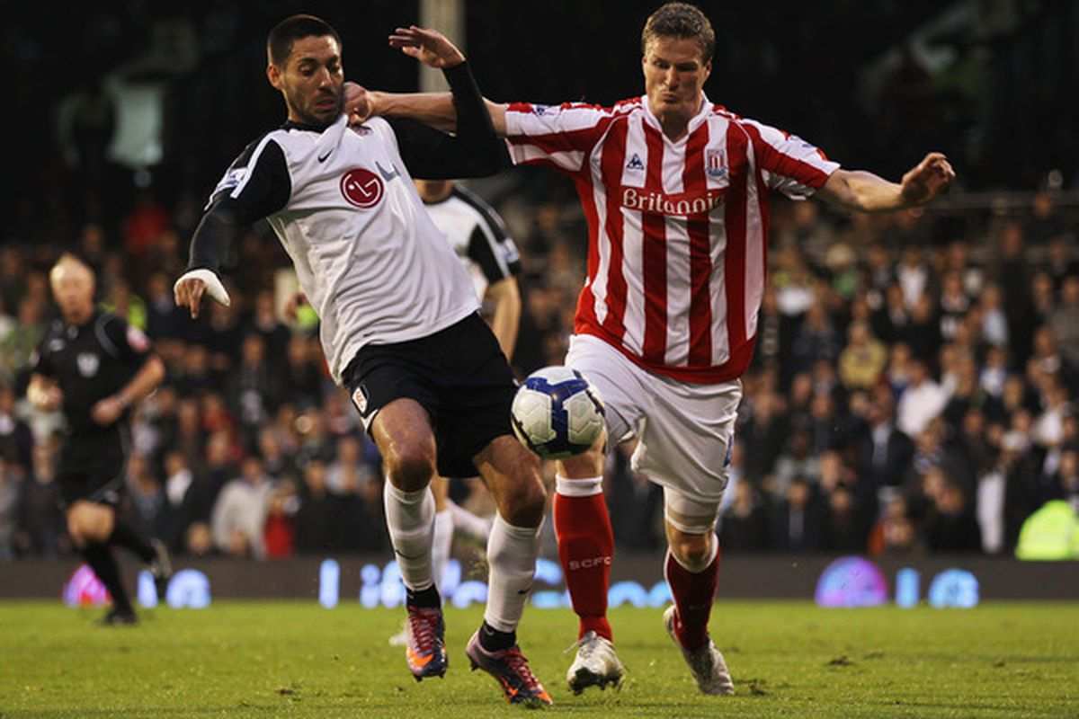 LONDON, ENGLAND - MAY 05:  Clint Dempsey of Fulham battles with Robert Huth of Stoke City during the Barclays Premier League match between Fulham and Stoke City at Craven Cottage on May 5, 2010 in London, England.  (Photo by Phil Cole/Getty Images)