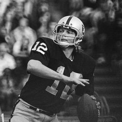 FILE - In this 1974 file photo, Oakland Raiders quarterback Ken Stabler looks to pass. Research on the brains of 202 former football players has confirmed what many feared in life _ evidence of chronic traumatic encephalopathy, or CTE, a devastating disease in nearly all the samples, from athletes in the NFL, college and even high school. Stabler is among the cases previously reported.