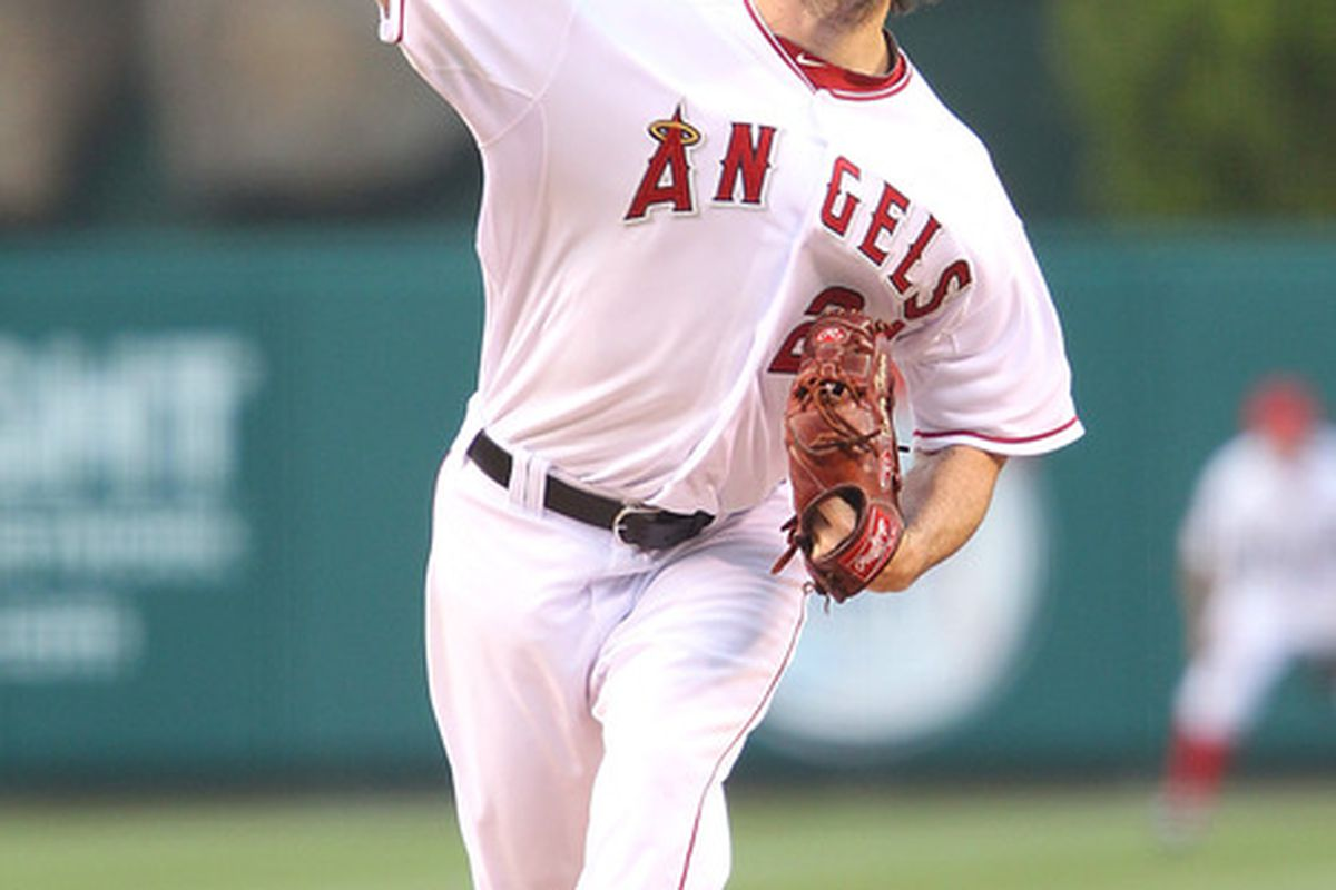 ANAHEIM, CA - MAY 24:  Dan Haren #24 of the Los Angeles Angels of Anaheim pitches in the first inning against the Oakland Athletics during the game at Angel Stadium on May 24, 2011 in Anaheim, California.  (Photo by Joe Scarnici/Getty Images)