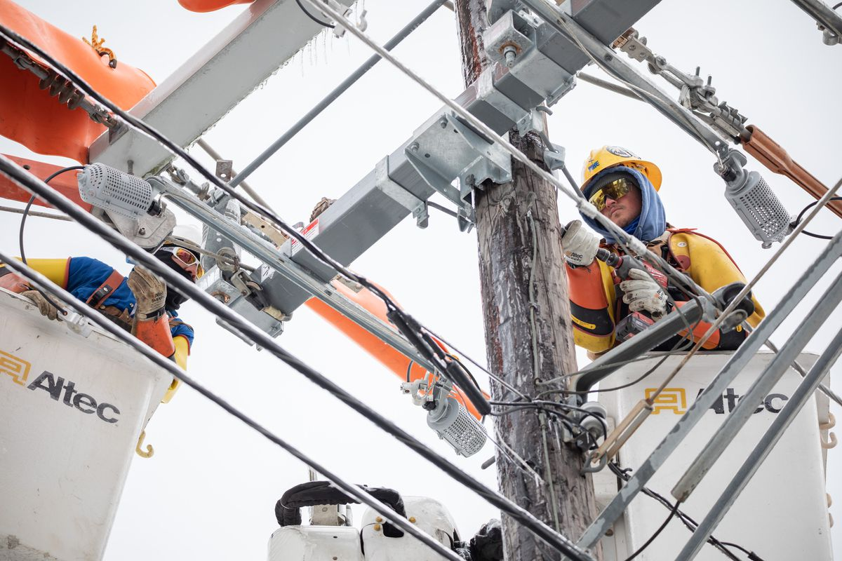 Workers repair a power line in Austin, Texas, on February 18, 2021.