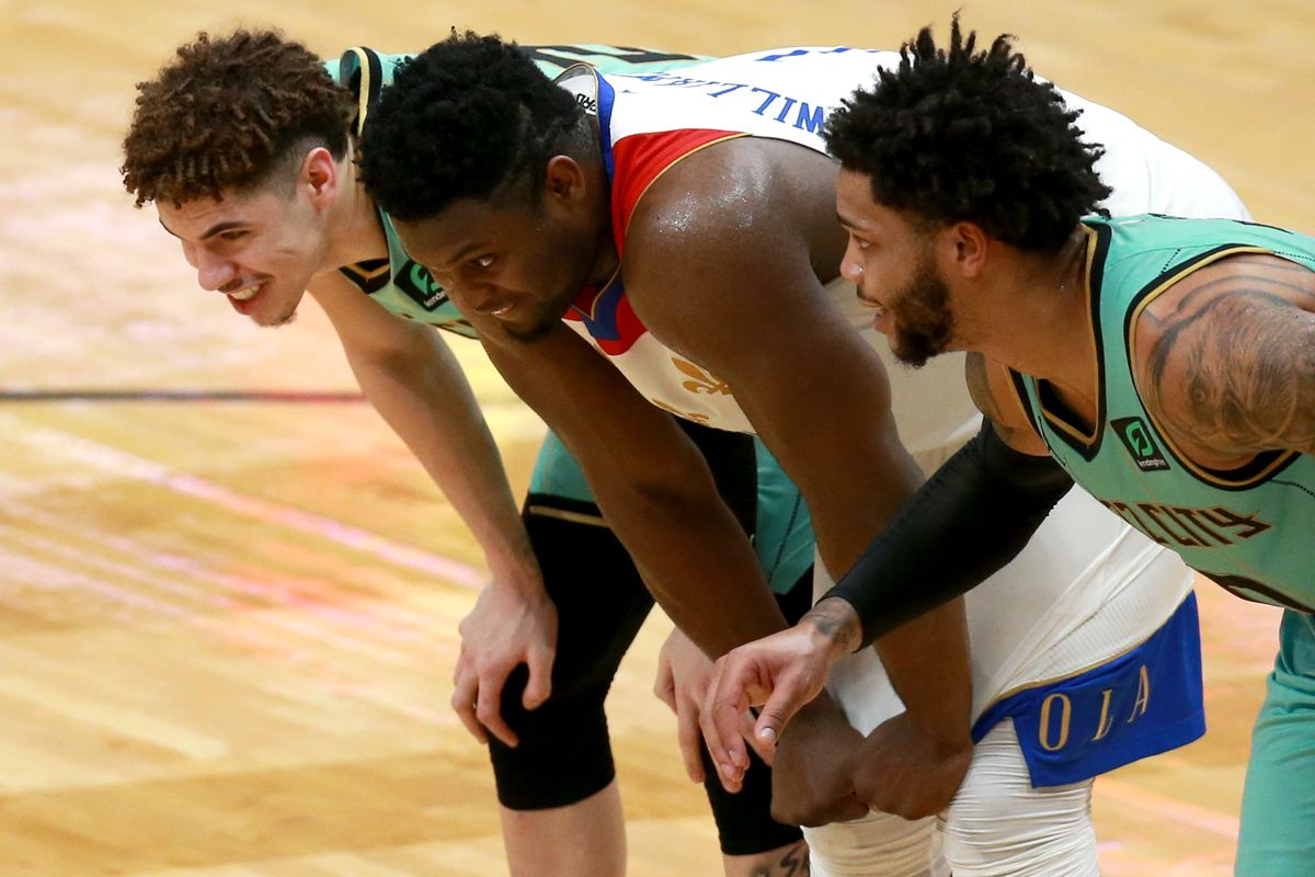 LaMelo Ball of the Charlotte Hornets talks with Zion Williamson of the New Orleans Pelicans during a NBA game at Smoothie King Center on January 08, 2021 in New Orleans, Louisiana.