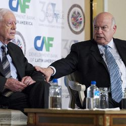 Former President Jimmy Carter, left, and Organization of American States (OAS)  Secretary General Jose Miguel Insulza participate in the 16th annual CAF conference, in Washington Thursday, Sep. 6, 2012.