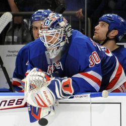 New York Rangers goaltender Henrik Lundqvist, of Sweden, looks on from the bench during the third period of Game 5 of an NHL Stanley Cup first-round hockey playoff series against the Ottawa Senators, Saturday, April 21, 2012, at New York's Madison Square Garden. The Senators won 2-0 to lead the series 3-2.