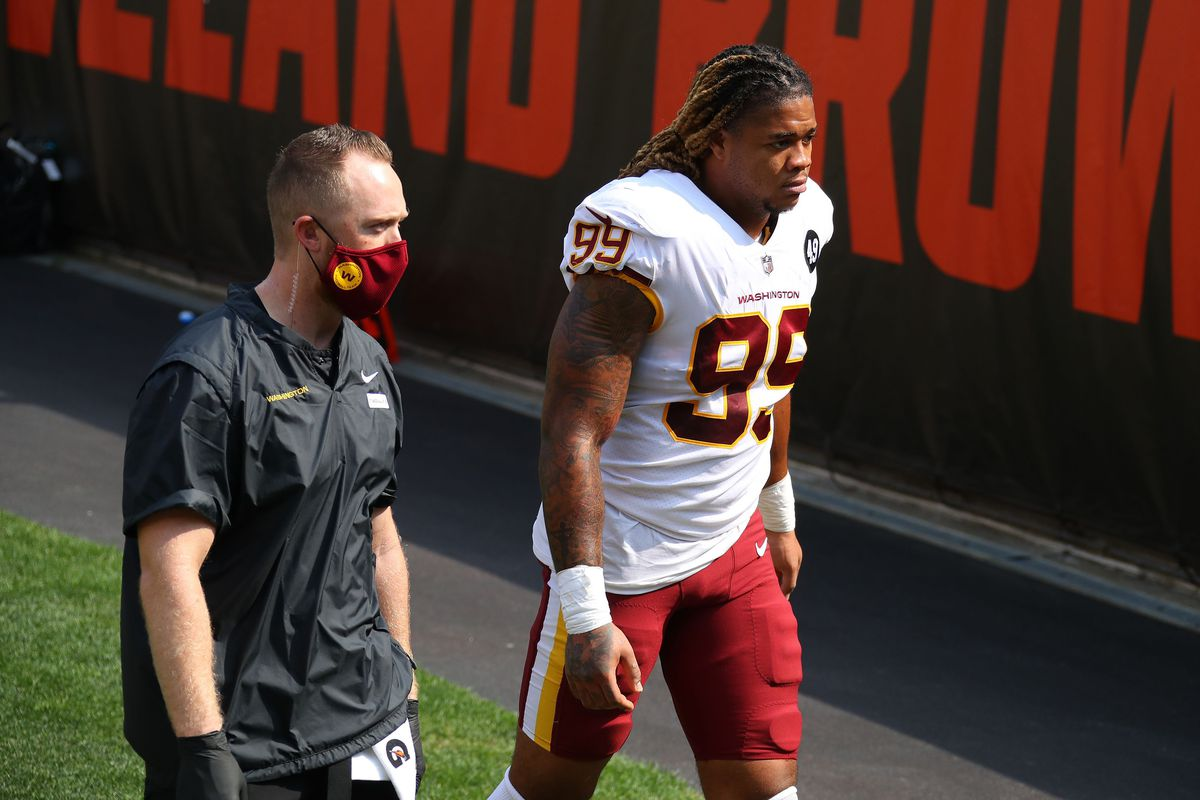 Chase Young of the Washington Football Team leaves the field after being injured while playing the Cleveland Browns at FirstEnergy Stadium on September 27, 2020 in Cleveland, Ohio.