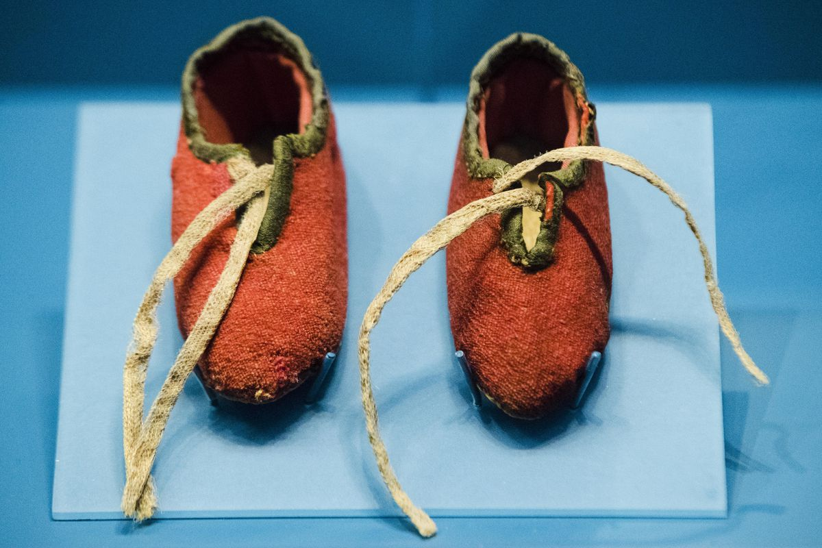This Tuesday, April 4, 2017, photo shows a newborn's shoes made from a British red coat brought back at the end of the Revolutionary War and preserved through generations of descendants of a Massachusetts soldier, at the Museum of the American Revolution