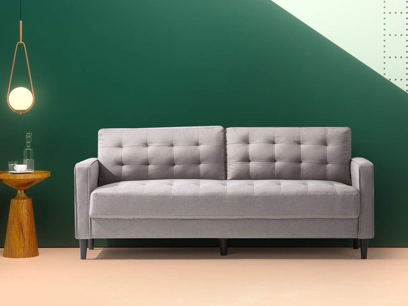 """This <a class=""""ql-link"""" href=""""https://amzn.to/2DweItZ"""" target=""""_blank"""" data-author=""""-1""""> midcentury-style sofa</a> is on sale for <span data-author=""""-1"""">$279.99 (usually $429)</span> ."""