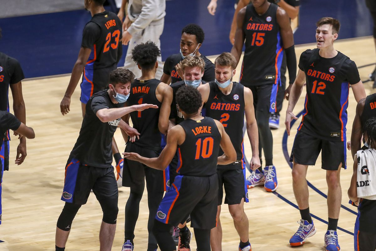 Florida Gators players celebrate after defeating the West Virginia Mountaineers at WVU Coliseum.