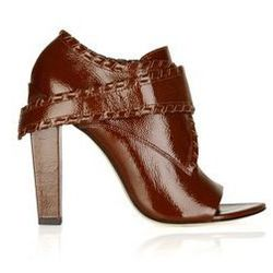 """<a href=""""http://www.theoutnet.com/product/242765"""">Cecilia glazed-leather ankle boots</a>, $174 (were $580)"""
