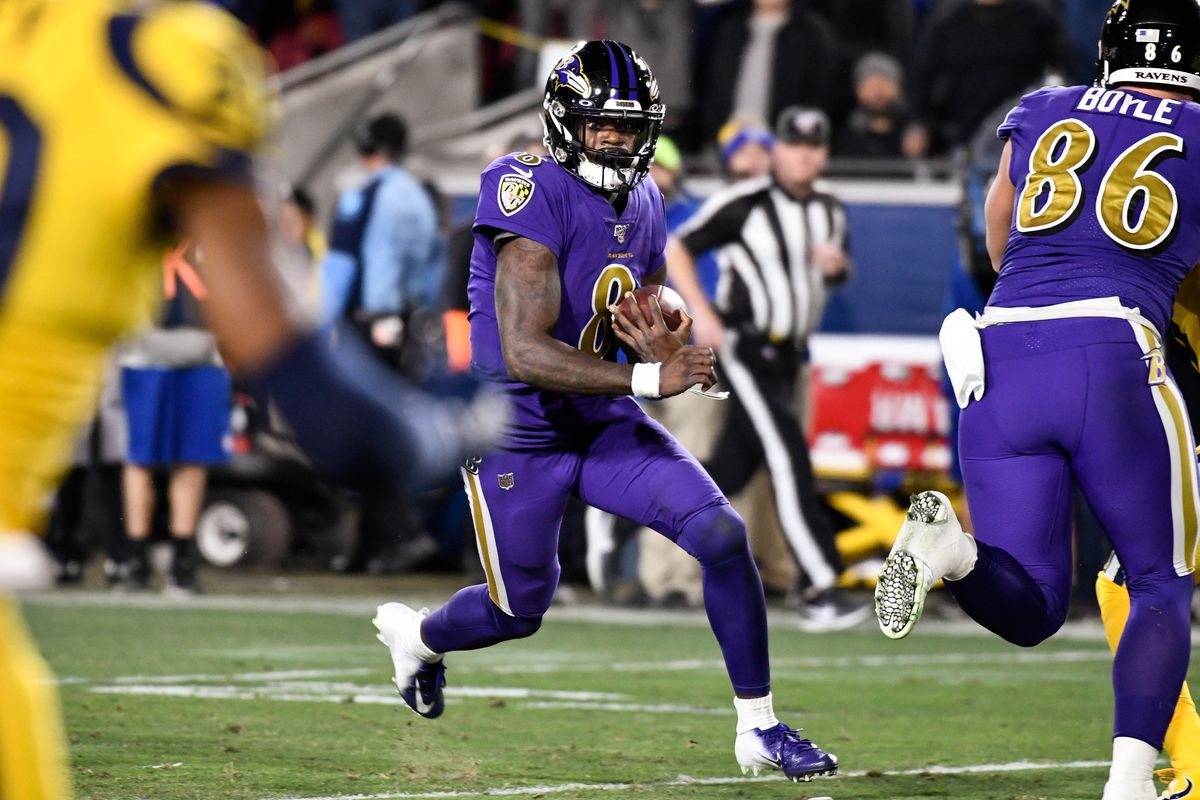 Baltimore Ravens quarterback Lamar Jackson carries the ball during the third quarter against the Los Angeles Rams at Los Angeles Memorial Coliseum.