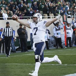 BYU quarterback Taysom Hill scores against the Michigan State Spartans  in East Lansing, MI on Saturday, Oct. 8, 2016. BYU won 31-14.
