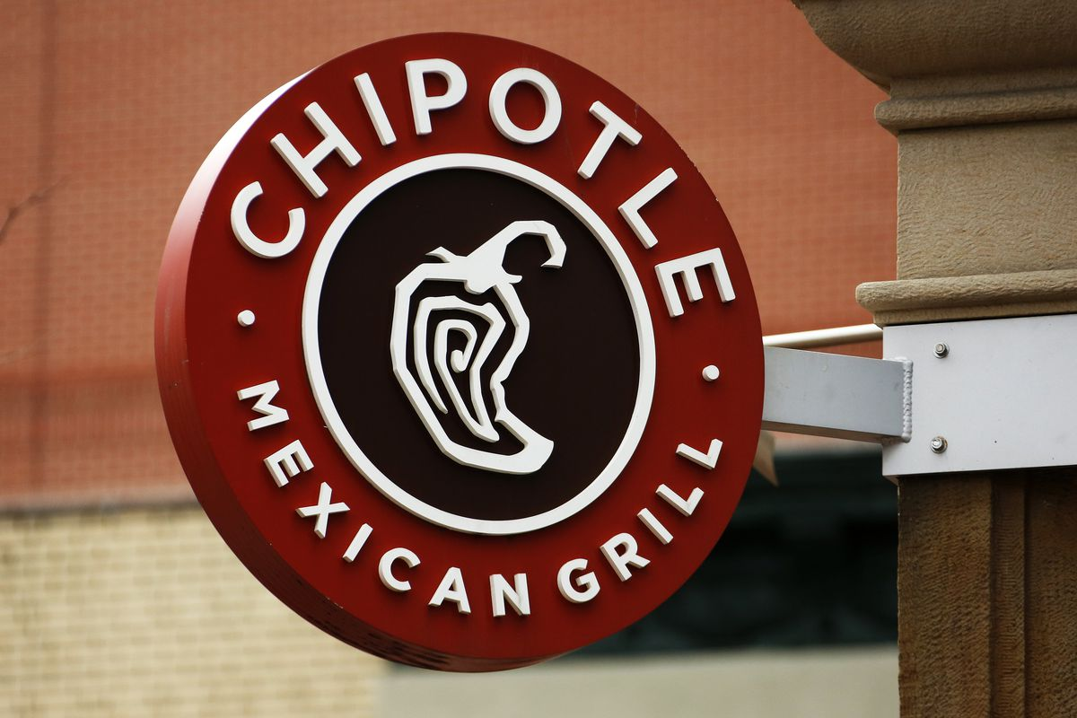This 2017 photo displays a Chipotle restaurant sign hanging in Pittsburgh, Pa. (