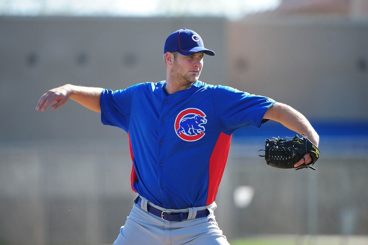 Mesa, AZ, USA; Chicago Cubs starting pitcher Chris Volstad performs a drill during spring training at Fitch Park. Credit: Kyle Terada-US PRESSWIRE