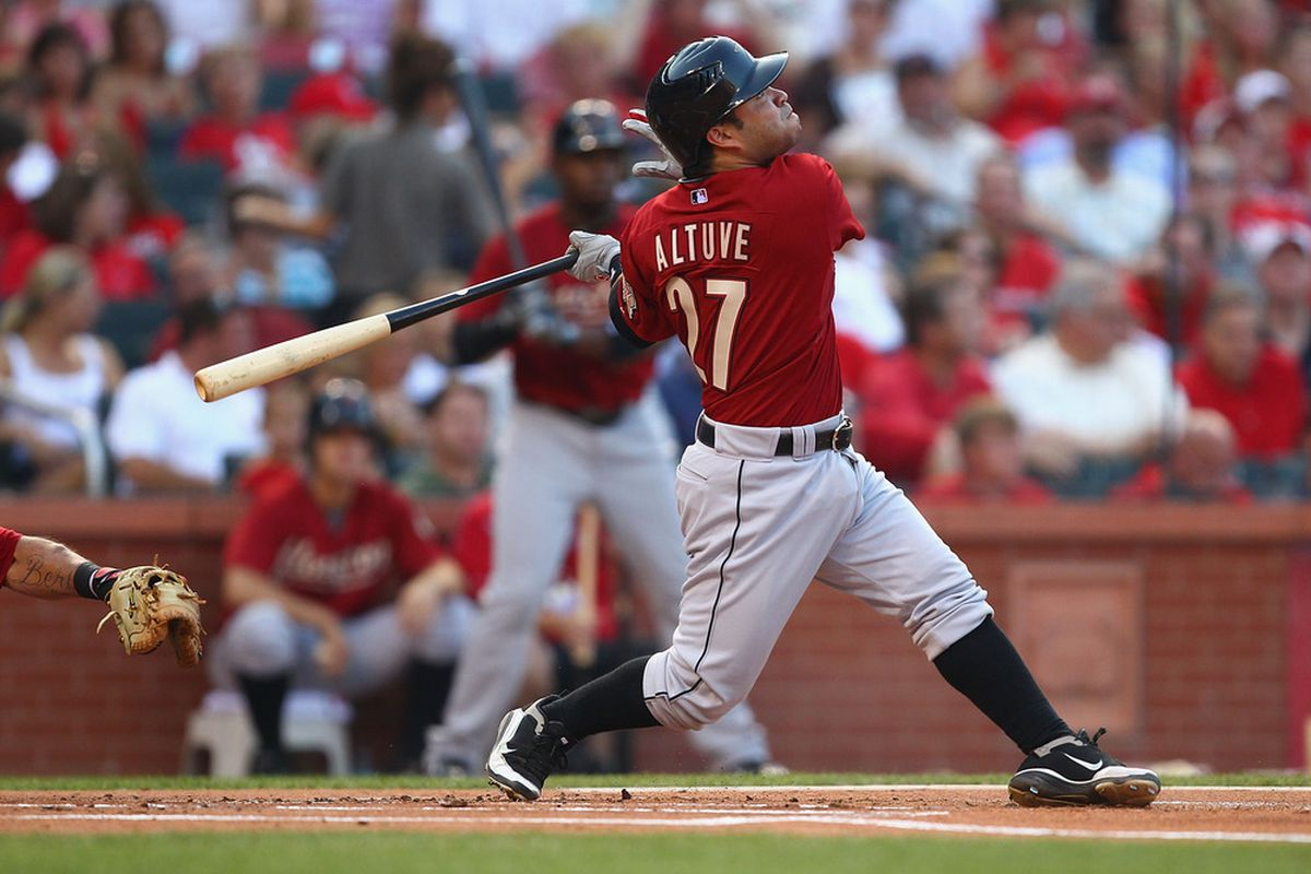 ST. LOUIS, MO - JULY 28: Jose Altuve #27 of the Houston Astros hits a sacrifice RBI against the St. Louis Cardinals at Busch Stadium on July 28, 2011 in St. Louis, Missouri.  The Astros beat the Cardinals 5-3.  (Photo by Dilip Vishwanat/Getty Images)