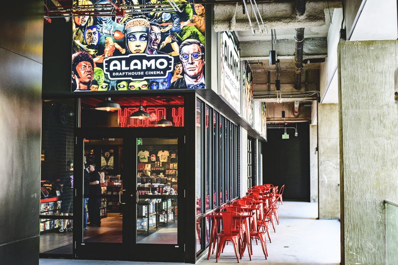 Alamo Drafthouse movie entrance with tables