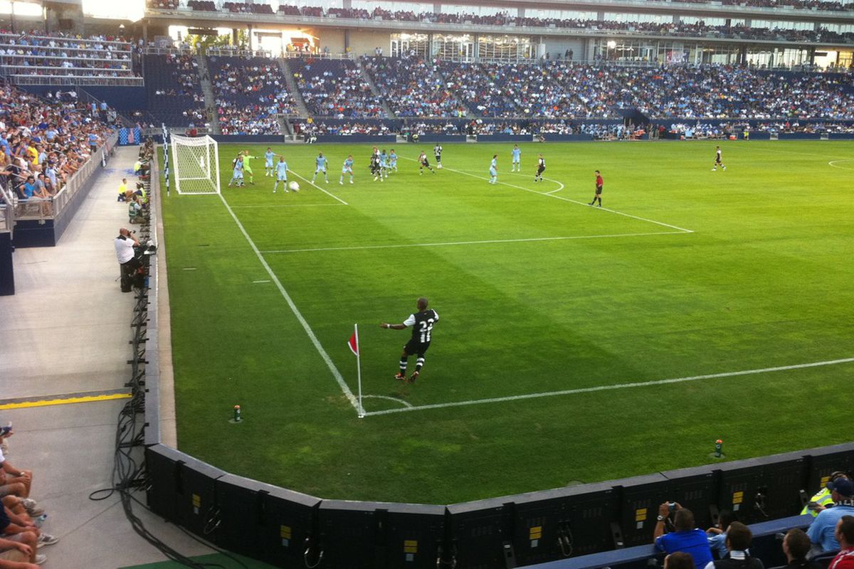 Sylvain Marveaux (#22) of Newcastle United launches a corner kick against Sporting Kansas City at LIVESTRONG Sporting Park in Kansas City, KS on July 20, 2011. (Robert L. Bishop/SBN)