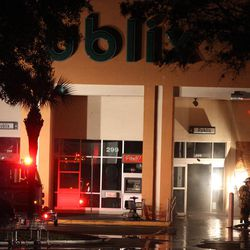 Fire crews work at the Publix Supermarket in DeLand, Fla., after a plane crashed into the roof of the building, Monday, April 2, 2012. The small plane sputtered and crashed in flames into the Florida shopping center, injuring at least five people as frightened shoppers rushed from the building, authorities and reports said.