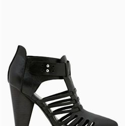 """<a href=""""http://www.nastygal.com/product/reaction-bootie/_/searchString/shoe%20cult"""">Reaction Bootie</a>, $158"""
