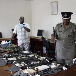 Kenya Police spokesman View Eric Kimathi displays siezed arms and  ammunition to journalists in Nairobi, Kenya, Friday, Sep. 14, 2012. Kenyan police say they have arrested two people suspected to have links with an al-Qaida-linked Somali militant group that was in the last stages of planning a major terrorist attack. Boniface Mwaniki , the head of Kenya's Anti-Terrorism Police Unit, said Friday that police found four suicide vests, a cache of weapons and 12 grenades. Al-Shabab has vowed to carry out terror attacks in Kenya in retaliation against the country for sending troops into Somalia.