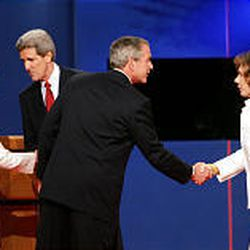 First lady Laura Bush, left, shakes hands with Democratic presidential candidate Sen. John Kerry, D-Mass., while President Bush shakes hands with Kerry's wife, Teresa Heinz Kerry, at the end of the presidential debate in Coral Gables, Fla. The debate was moderated by Jim Lehrer of PBS.