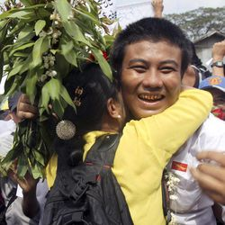 In this photo taken on Jan. 13, 2012, a freed Myanmar political prisoner, right, is welcomed by his friend as he comes out of Insein prison in Yangon, Myanmar. Myanmar's government said Monday, Sept. 17, 2012 it has granted amnesties for 514 prisoners, including some foreigners, on humanitarian grounds.