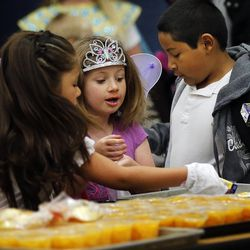 Andrea, left, Hailey and Diego choose their food during the Breakfast in the Classroom program at Backman Elementary School in Salt Lake City on Friday, Oct. 28, 2016.