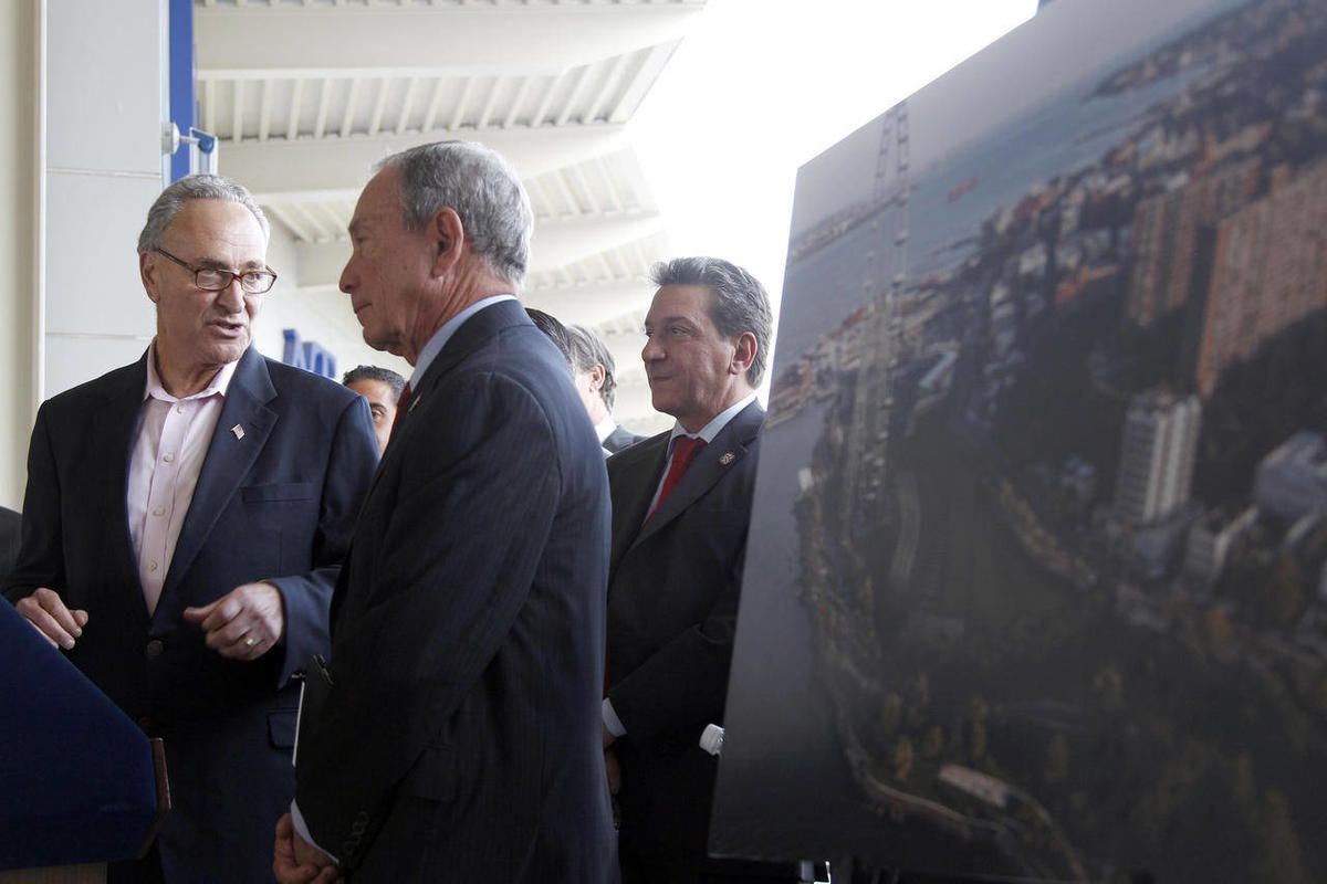 Sen. Charles Schumer, D-N.Y., and New York City Mayor Michael Bloomberg stand next to an artist rendering of a proposed Ferris wheel during a news conference on the Staten Island borough of New York, Thursday, Sept. 27, 2012.  The proposed 625-foot Ferris