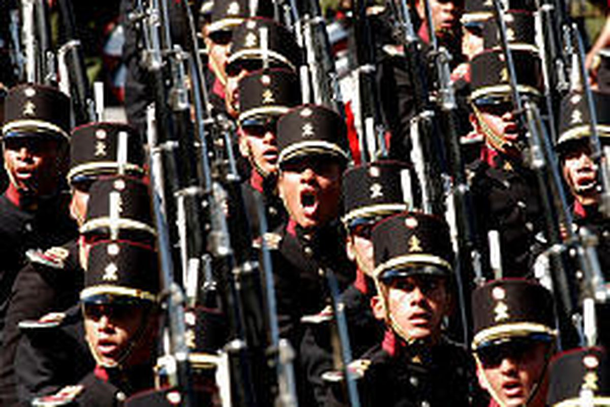 Troops march during Independence Day celebrations Tuesday at Mexico City's Zocalo Plaza. Festivities began Monday night with the ringing of the original independence bell.