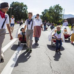 Kids walk behind the Centerville Utah Stake float during the Days of '47 Union Pacific Railroad Youth Parade held Saturday, July 18, 2015, in Salt Lake City.