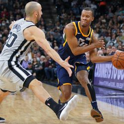 Utah Jazz's Rodney Hood, right, looks to pass the ball as San Antonio Spurs' Manu Ginobili defends during the second half of an NBA basketball game Saturday, Feb. 3, 2018, in San Antonio. Utah won 120-111. (AP Photo/Darren Abate)