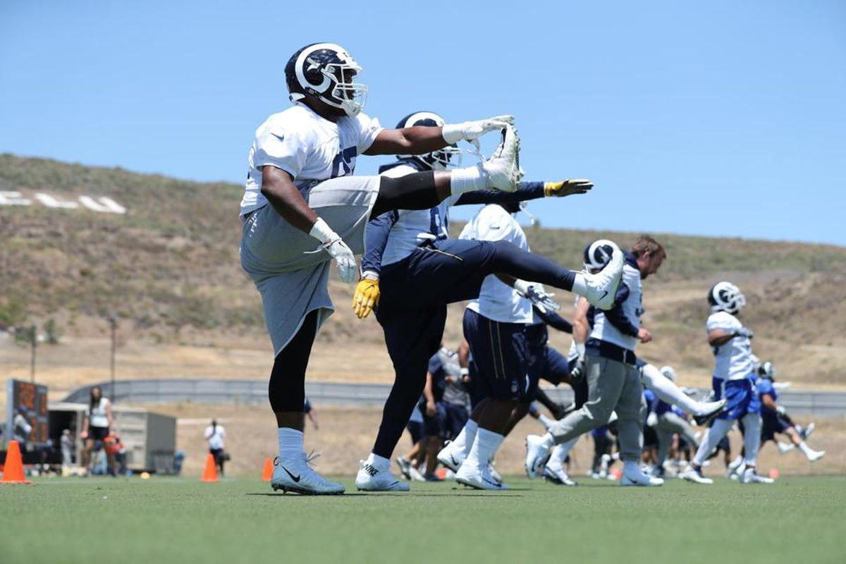 Los Angeles Rams players warm up at minicamp, June 12, 2018.