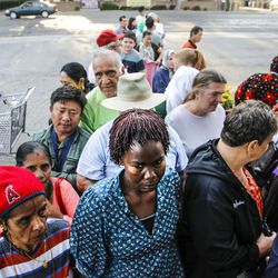 Refugees from Bhutan, Iraq, Sierra Leone, Guatemala and Peru line up to receive clothes and food at the Mosaic Inter-Faith center in Salt Lake City on Thursday, Aug. 4, 2016.