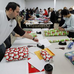 Volunteers collect and wrap presents at the 13th annual Giving Tree program at Valley Fair Mall in West Valley City on Tuesday, Dec. 15, 2015. The program provides Christmas presents to 170 children from 61 low-income families in the city.