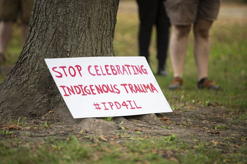 Signs are placed on a tree at Pottawattomie Park at 7340 N. Rogers Ave in Rogers Park to protest after Cook County Commissioners refused to advance a measure replacing Columbus Day with Indigenous Peoples' Day, Monday, Oct. 11, 2021.   Anthony Vazquez/Sun-Times