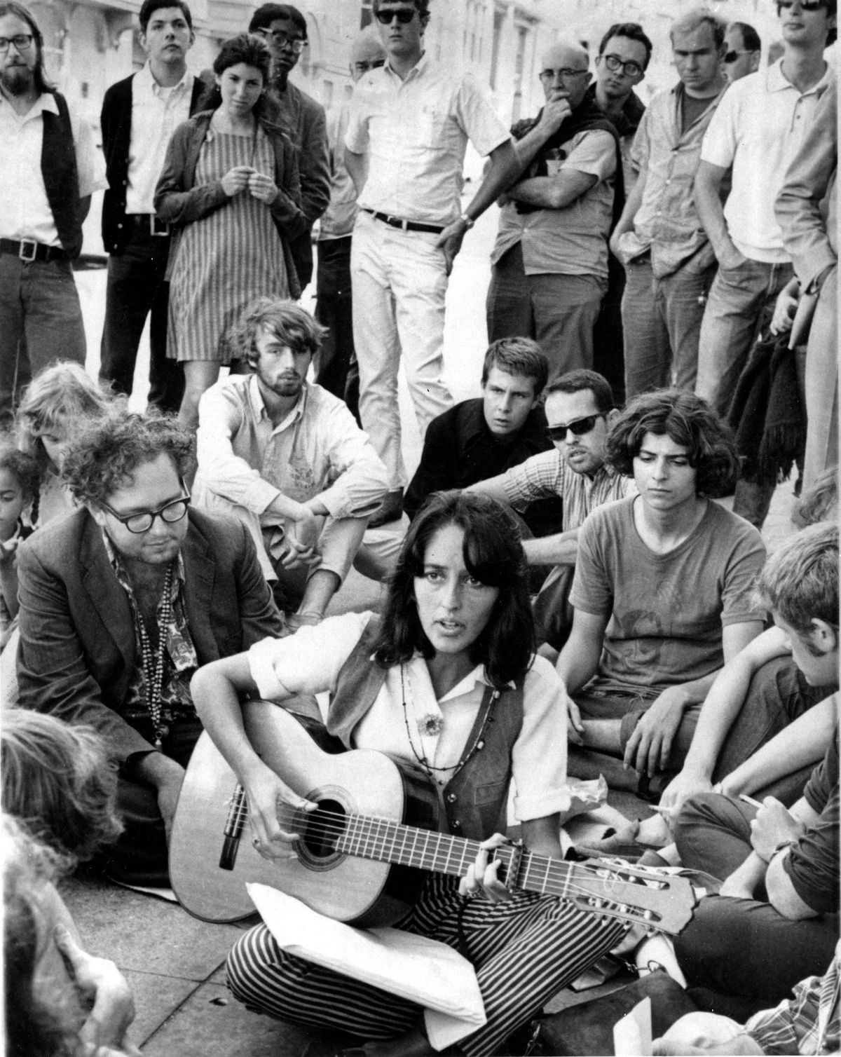 A more familiar scene from the Summer of Love: Joan Baez performs at the corner of Haight and Ashbury, September 1967.