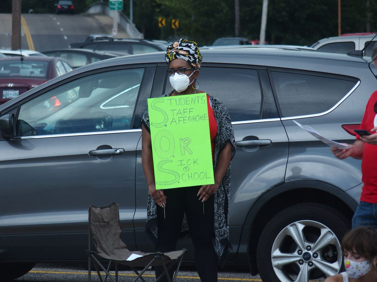 Lisa Bennett, a professional learning coach at Cordova High School, protests reopening school buildings.