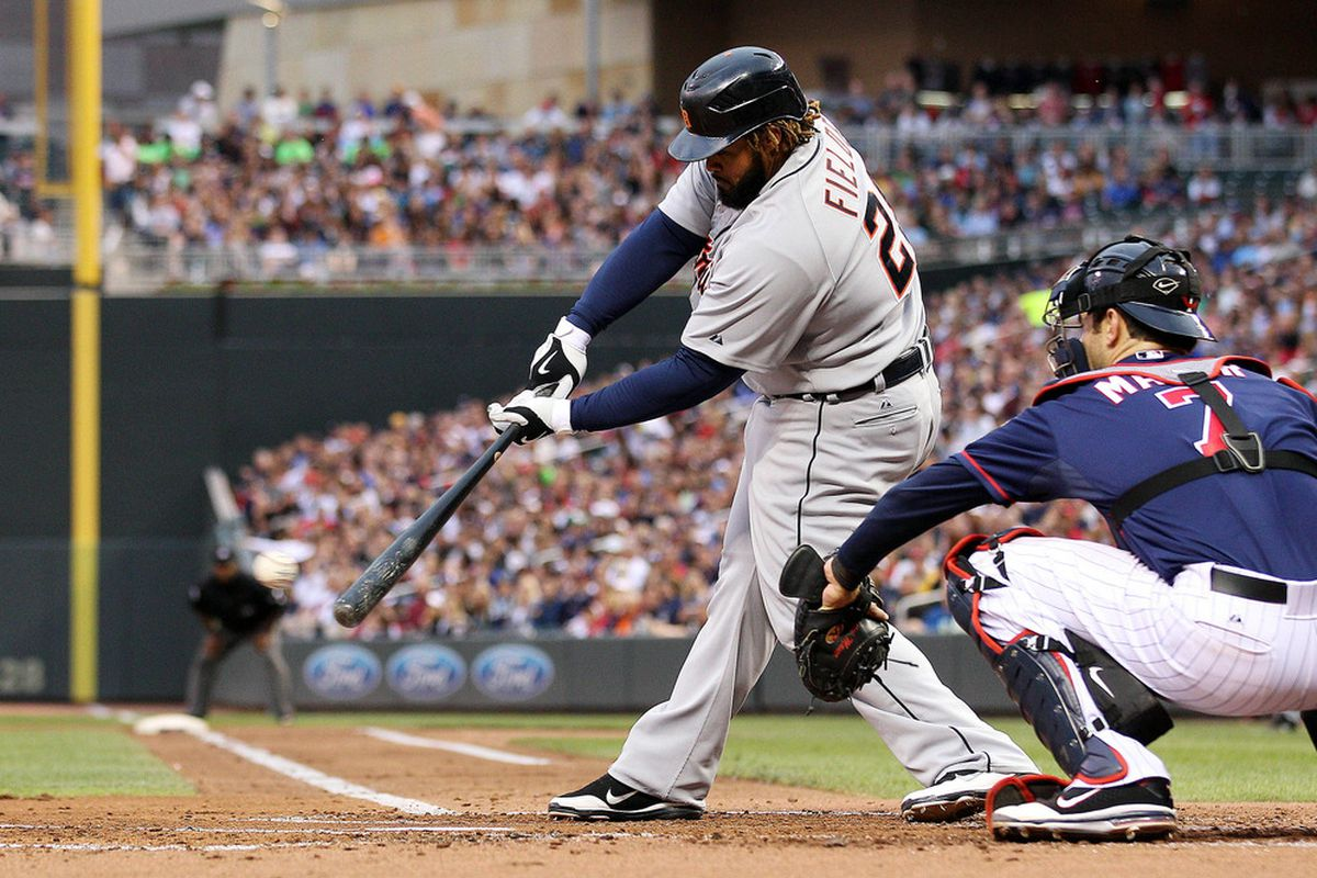 May 25, 2012; Minneapolis, MN, USA: Detroit Tigers first baseman Prince Fielder (28) hits a single in the second inning against the Minnesota Twins at Target Field. Mandatory Credit: Jesse Johnson-US PRESSWIRE
