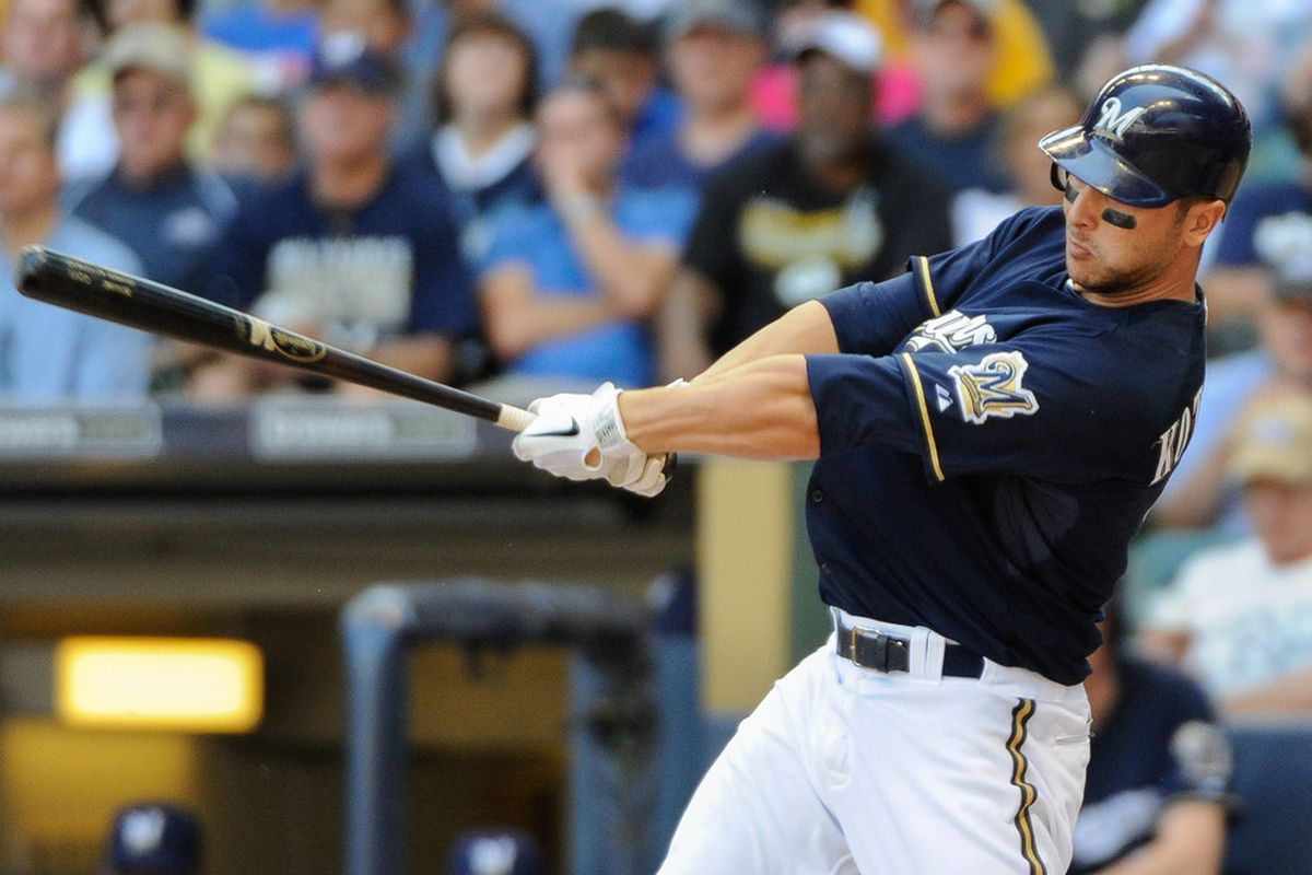 June 7, 2012; Milwaukee, WI, USA;  Milwaukee Brewers catcher George Kottaras (9) drives in a run with a single in the sixth inning against the Chicago Cubs at Miller Park.  Mandatory Credit: Benny Sieu-US PRESSWIRE