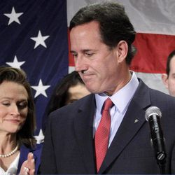 Former Pennsylvania Sen. Rick Santorum turns to his wife Karen, left, after announcing he is suspending his candidacy for the presidency, Tuesday, April 10, 2012, in Gettysburg, Pa.