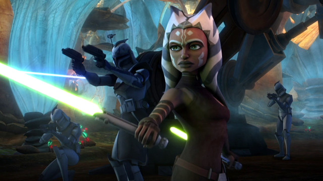 ahsoka tano holds out a green lightsaber in star wars: the clone wars