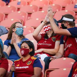 Real Salt Lake fans chat and high-five each other before an MLS soccer game against Colorado Rapids at Rio Tinto Stadium in Sandy on Saturday, Sept. 12, 2020.