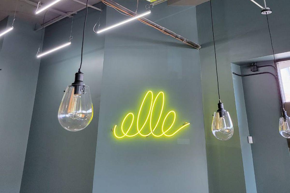 "neon light that says ""elle"""