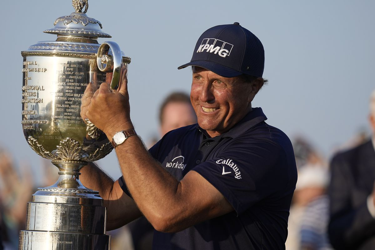 Phil Mickelson holds the Wanamaker Trophy after winning the PGA Championship on the Ocean Course in Kiawah Island, S.C.