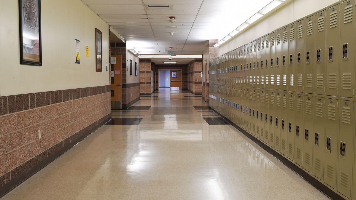 An empty hallway with a row of lockers in a Colorado high school