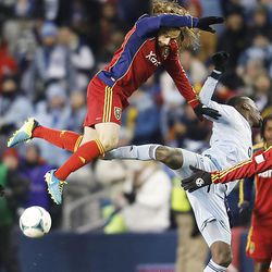 Real's Ned Grabavoy and Kansas City's C.J. Sapong crash into each other as they try for the ball as Real Salt Lake and Sporting KC play Saturday, Dec. 7, 2013 in MLS Cup action. Sporting KC won in a shootout.