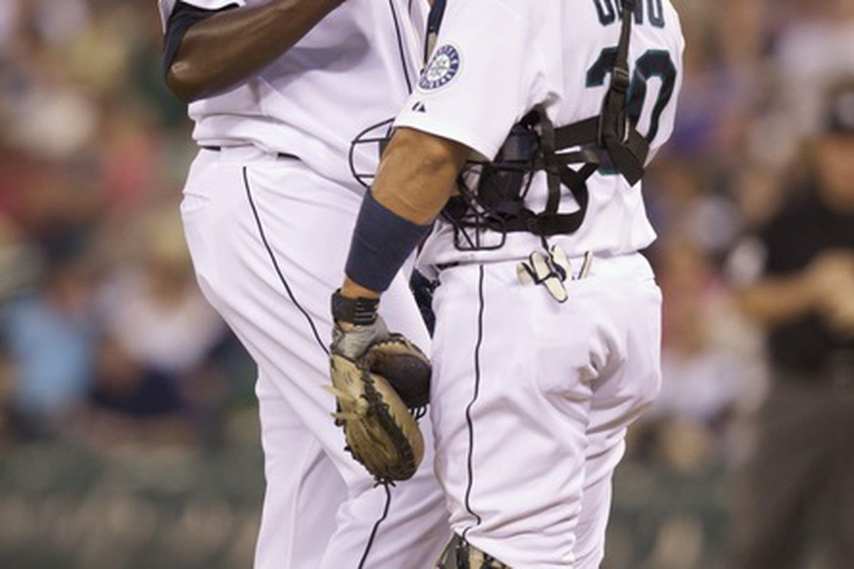 """Michael Pineda explains to Miguel Olivio that he's 6'5"""", 245 pounds. (Photo by Stephen Brashear/Getty Images)"""
